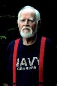 John E.  Koczy