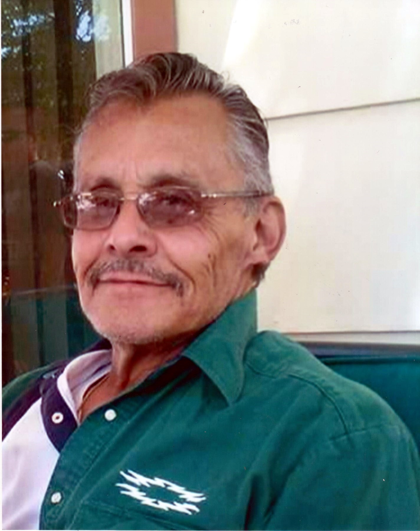 Michael E.  Martinez